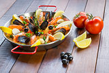 Paella with seafood vegetables and saffron served in the traditi