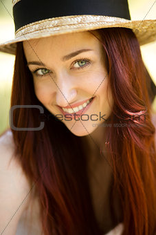 Close up portrait of sexy young lady in straw hat.