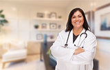 Female Hispanic Doctor or Nurse Standing in Her Office