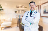 Handsome Hispanic Doctor or Nurse Standing in His Office