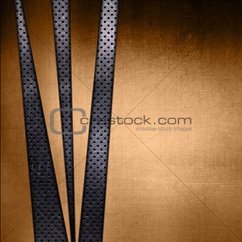 Abstract gold texture on a perforated metallic background