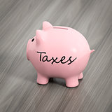 a pink piggy bank with the word taxes