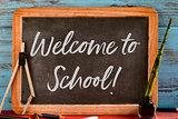 text welcome to school written in a chalkboard