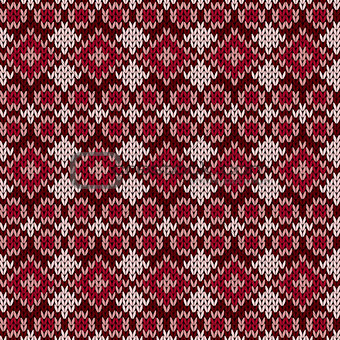 Knitted seamless pattern in red hues