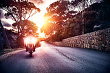 Motorcyclist in sunset light