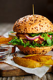 Tasty beef burger with lettuce and mustard