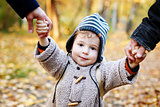 Cute smilimg kid in warm clothes  having fun