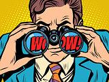 wow Businessman looking through binoculars