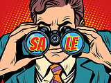 Sale Businessman looking through binoculars