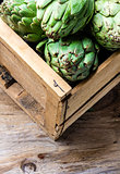 Artichoke. Box of fresh artichoke. Harvest concept. Copy space