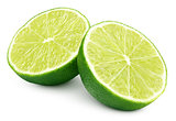 Two halves of green lime citrus fruit on white
