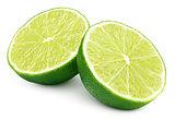 Two halves of green lime citrus fruit on white