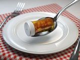 Pills in the plate with fork and spoon. Pharmacy diet nutrition
