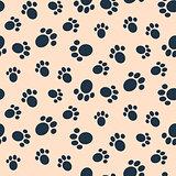 Dog paw print vector seamless pattern.
