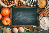 Empty chalkboard and ingredients for baking