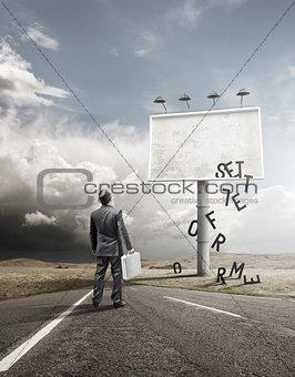 Businessman and Blank Billboard