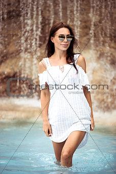 Beautiful girl in the waterfall