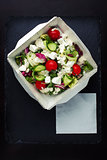Greek salad with brynza top view.