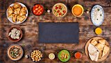 Assorted indian food on a wooden background. Dishes and appetizers of indian cuisine.