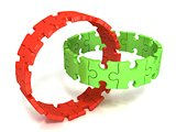 Two red and green puzzle rings