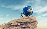 Man pushing a big earth globe