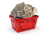 Houses is in a shopping basket. real estate market concept.