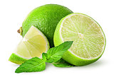 Whole and few pieces of lime with mint