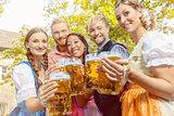 Friends in beer garden with beer glasses
