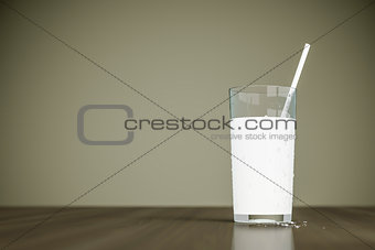 a glass of milk with a straw