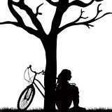Woman and bicycle leaned against a tree