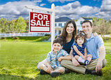 Young Family With Children In Front of Custom Home and For Sale