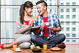 Young indonesian couple having breakfast