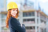 portrait of a female architect in a yellow helmet at a construct