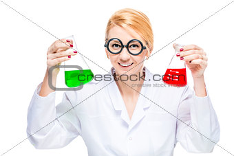 Blond chemist holds a test tube with a colored liquid on a white