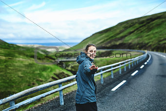 Cheerful traveler on background of road
