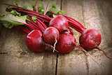 Fresh beetroot i on rustic wooden background. Harvest vegetable cooking conception . Diet or vegetarian food concept