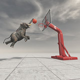 An elephant throws the ball at the basket.