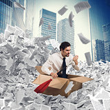 Businessman extricate himself from a sea of paper