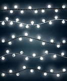 Set of white garland style christmas lights on the dark blue background. Vector design of outdoor patio incandescent light strings.