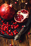 Pomegranates with Seeds and Knife.