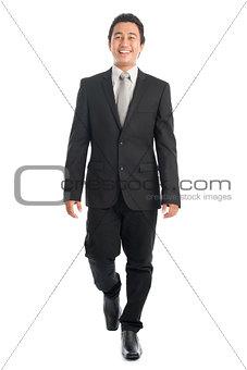 Asian businesspeople walking