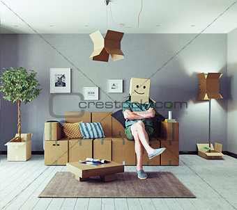 man in cardboard boxes design room