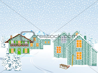 Snowy village in winter landscape in the mountains