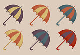 Umbrellas set of icons, vintage style. Beach multicolored umbrella retro collection of design elements. Vector illustration.