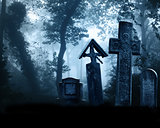 Medieval stone crosses and tombstones, cemetery in misty forest