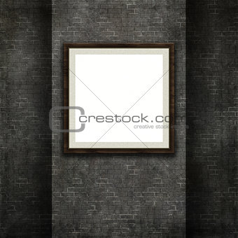 3D picture frame on a grunge brick wall texture