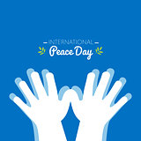 International peace day with hands making the shape of a dove