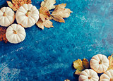 Decorative pumpkins on blue shabby background.