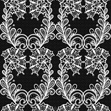 White lace seamless pattern on black background.