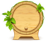 Wooden barrel for wine and beer. Green leaves of hops on barrel